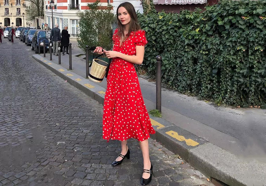 a-girl-wears-a-long-red-dress-with-white-dots