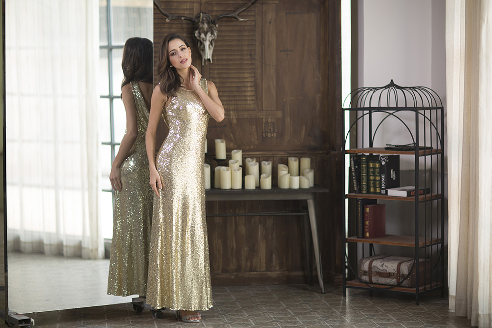 a beautiful girl in ever pretty golden sequin dress