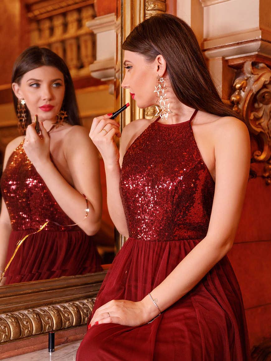Larisa-wears-a-burgundy-sequin-dress