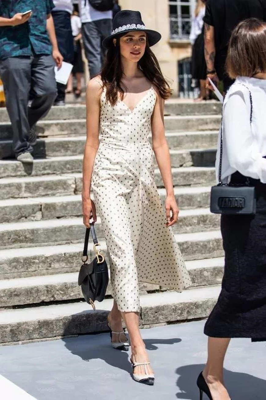 a-woman-wears-a-dior-polka-dot-dress
