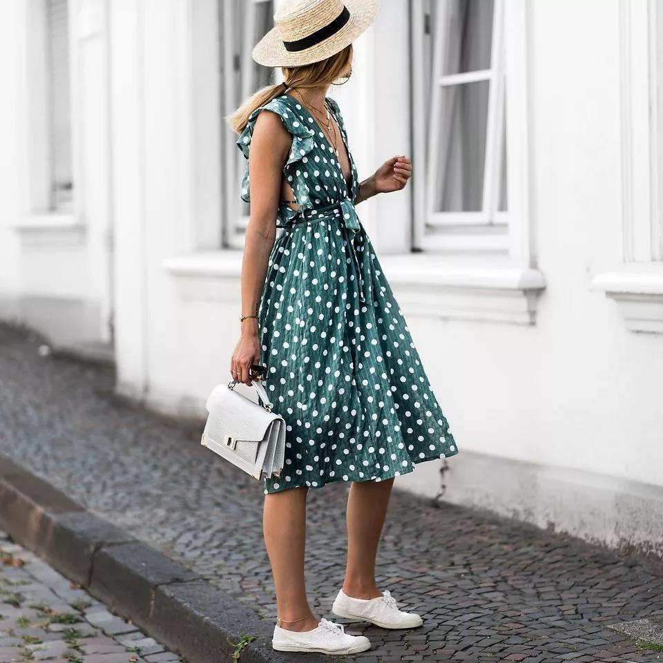 a-beautiful-girl-wears-a-green-dress-with-white-dots