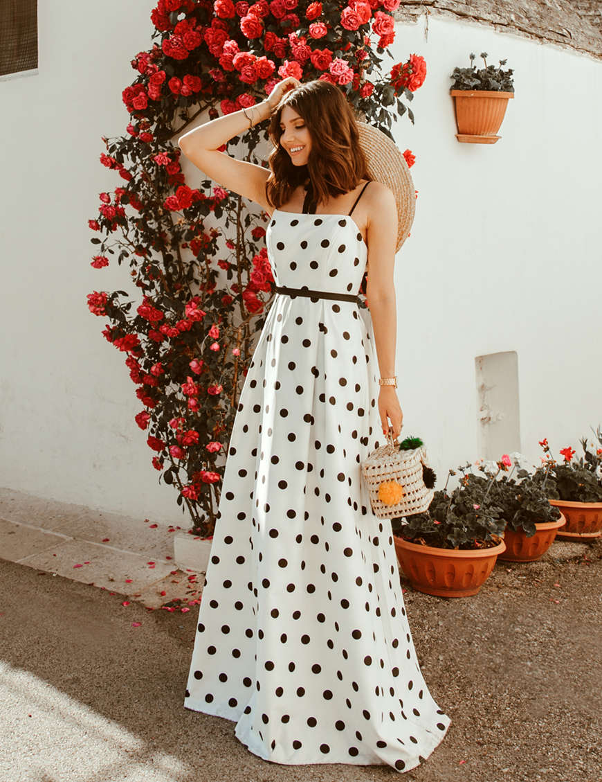 Larisa-wears-a-long-white-dress-with-balck-dots