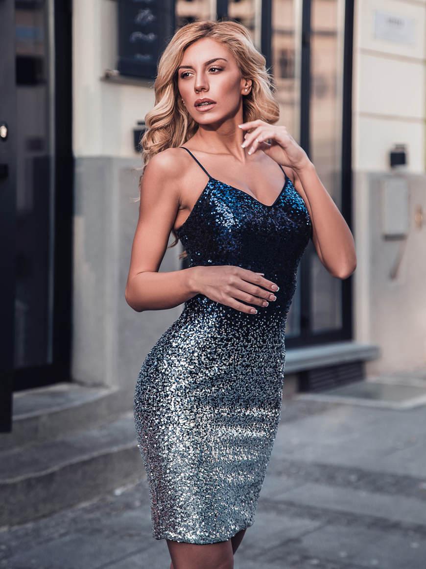 a-woman-wear-a-navy-blue-sequin-dress