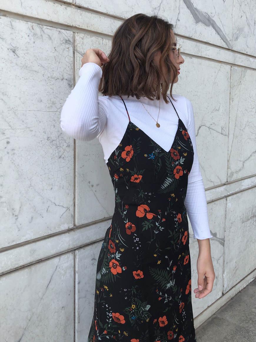 a-beautiful-woman-wears-a-floral-print-dress