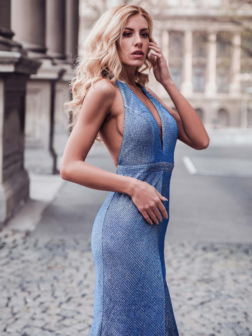 a-woman-wears-a-long-blue-dress