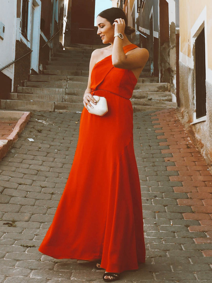 a-woman-wears-a-long-orange-dress