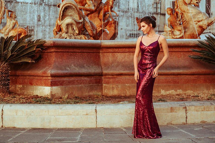 a-woman-wears-a-sequin-burgundy-dress