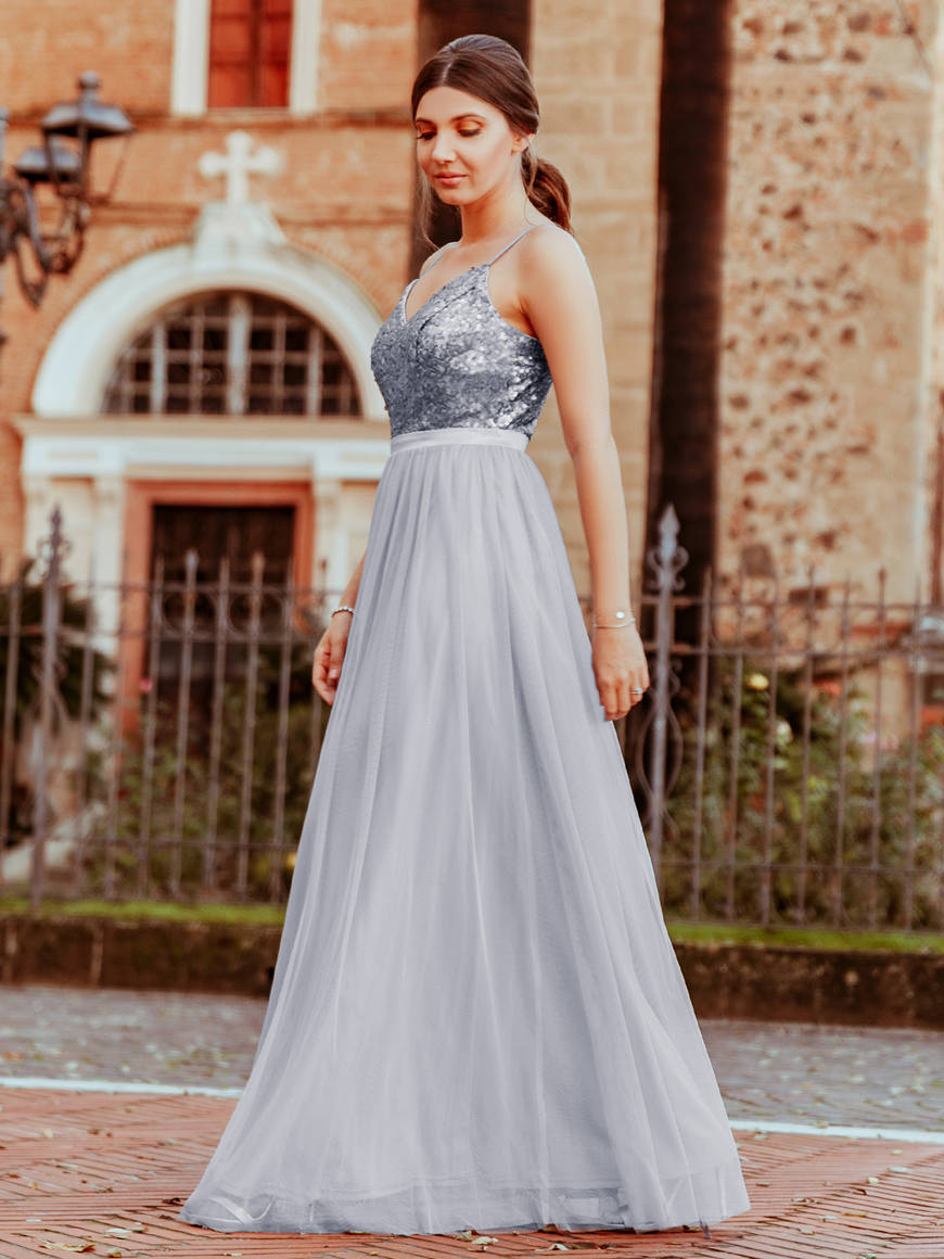 Larisa-wears-a-long-dress-with-sequin-bust