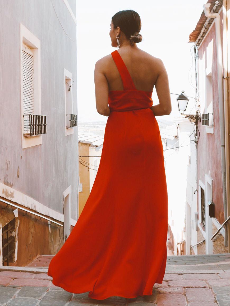 the-back-of-a-long-orange-dress