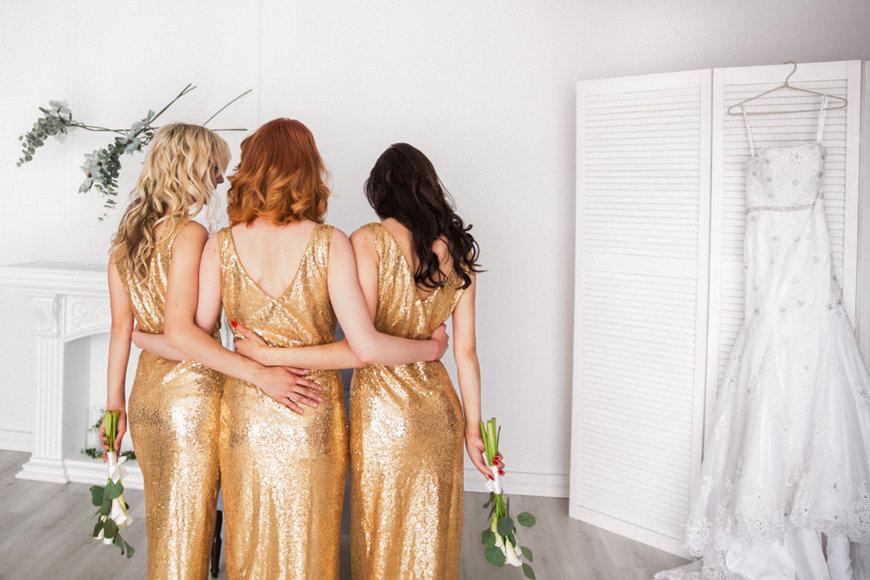 three-brideamaids-wearing-golden-sequin-dresses