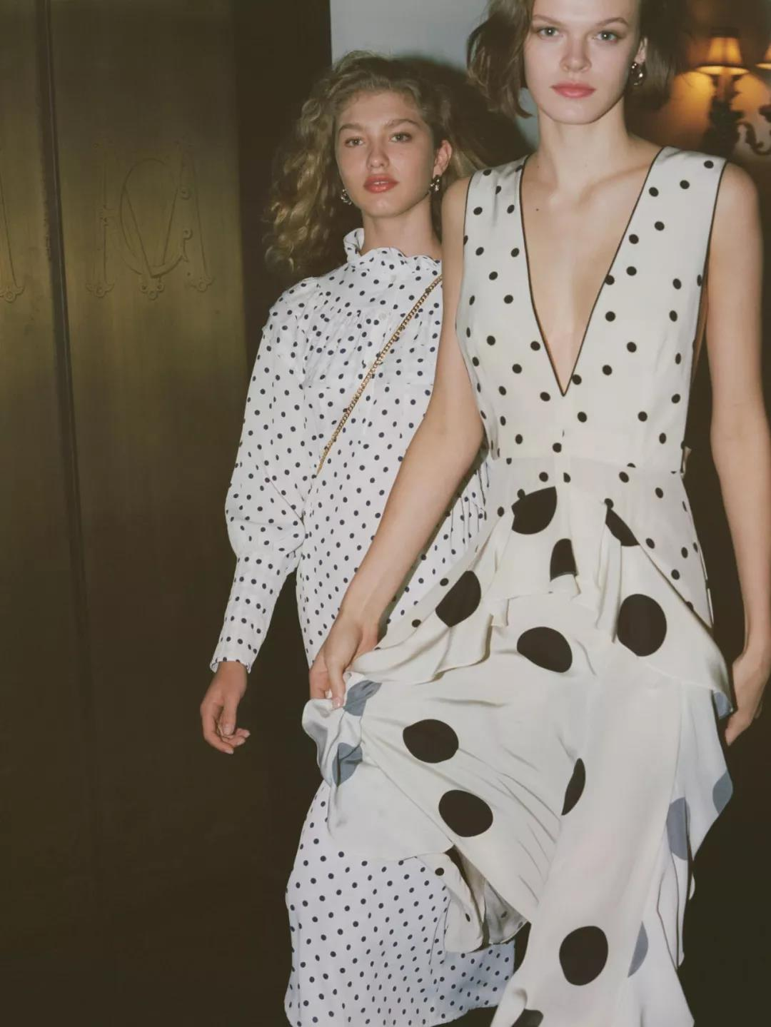 two-girls-wear-white-dresses-with-black-dots