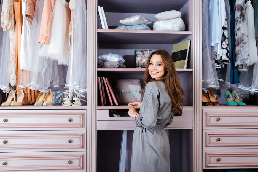a-woman-stands-in-front-of-her-closet