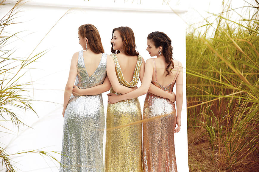three-women-wearing-sequin-bridesmaid-dresses