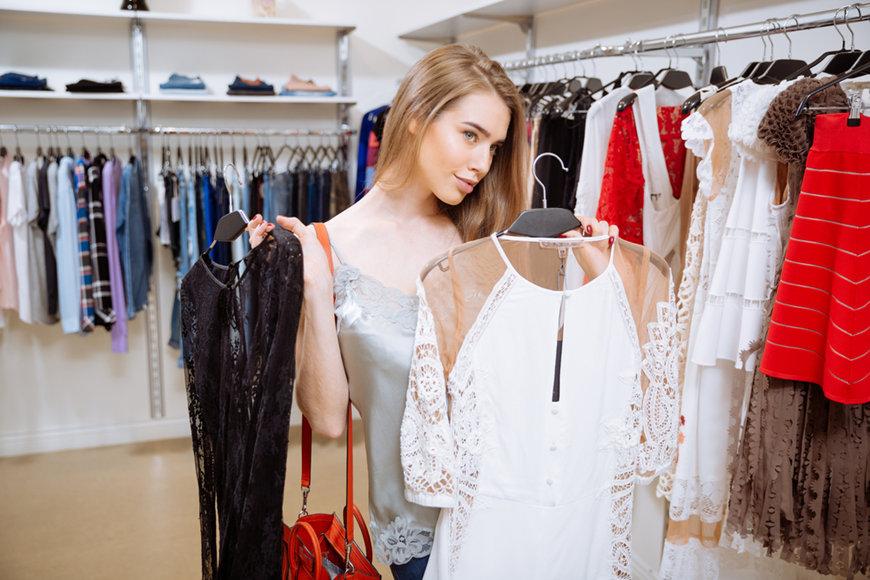 a-woman-is-choosing-a-formal-dress
