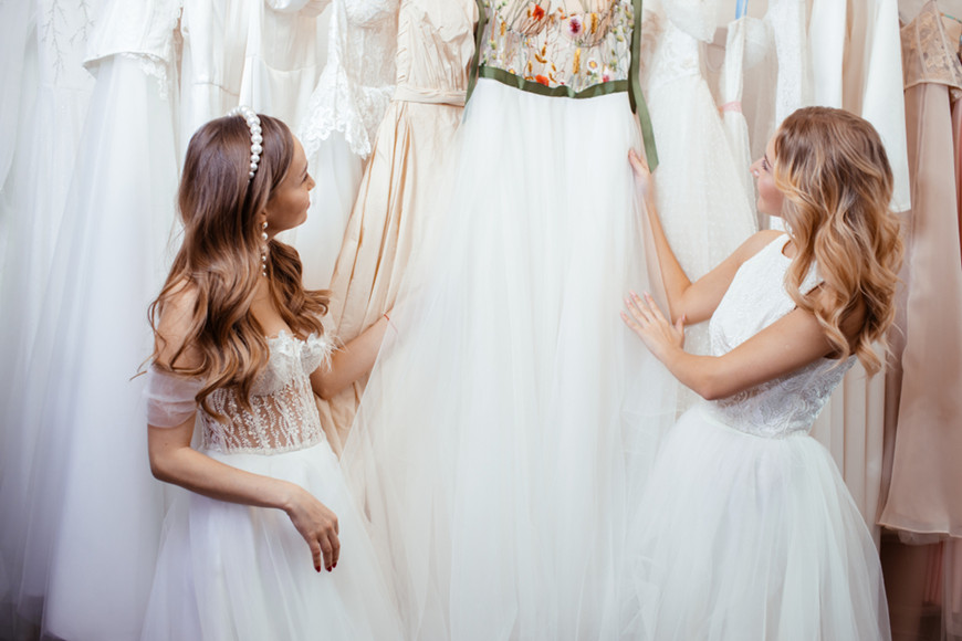 two-girls-are-choosing-white-dresses