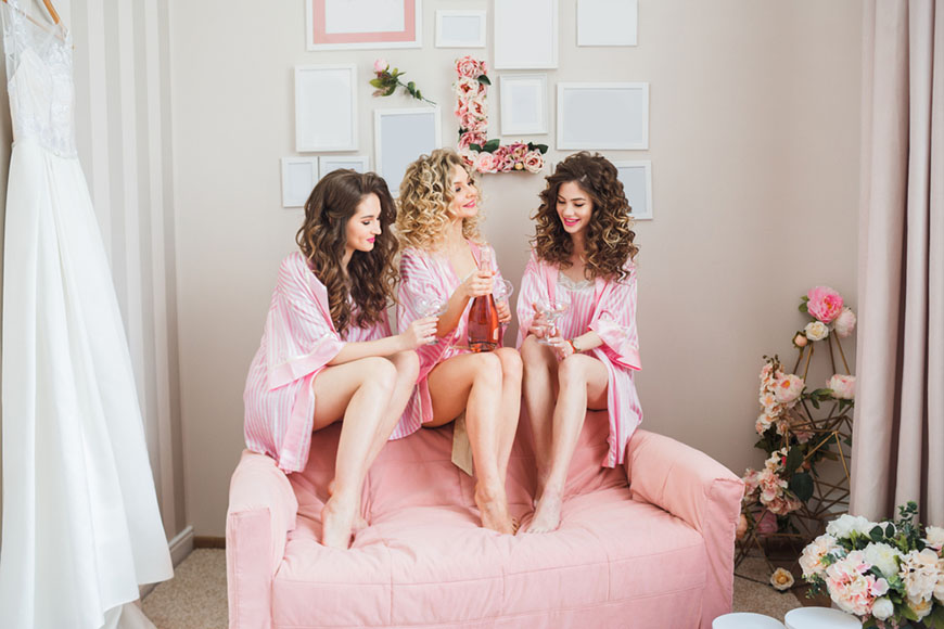 three-women-wearing-pink-pajamas