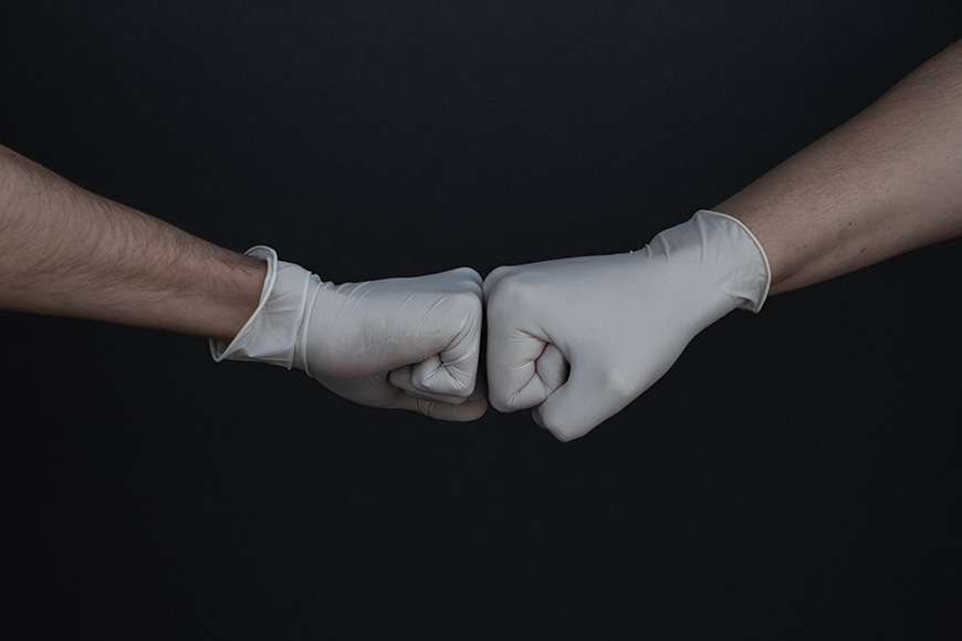 two-hands-wearing-gloves