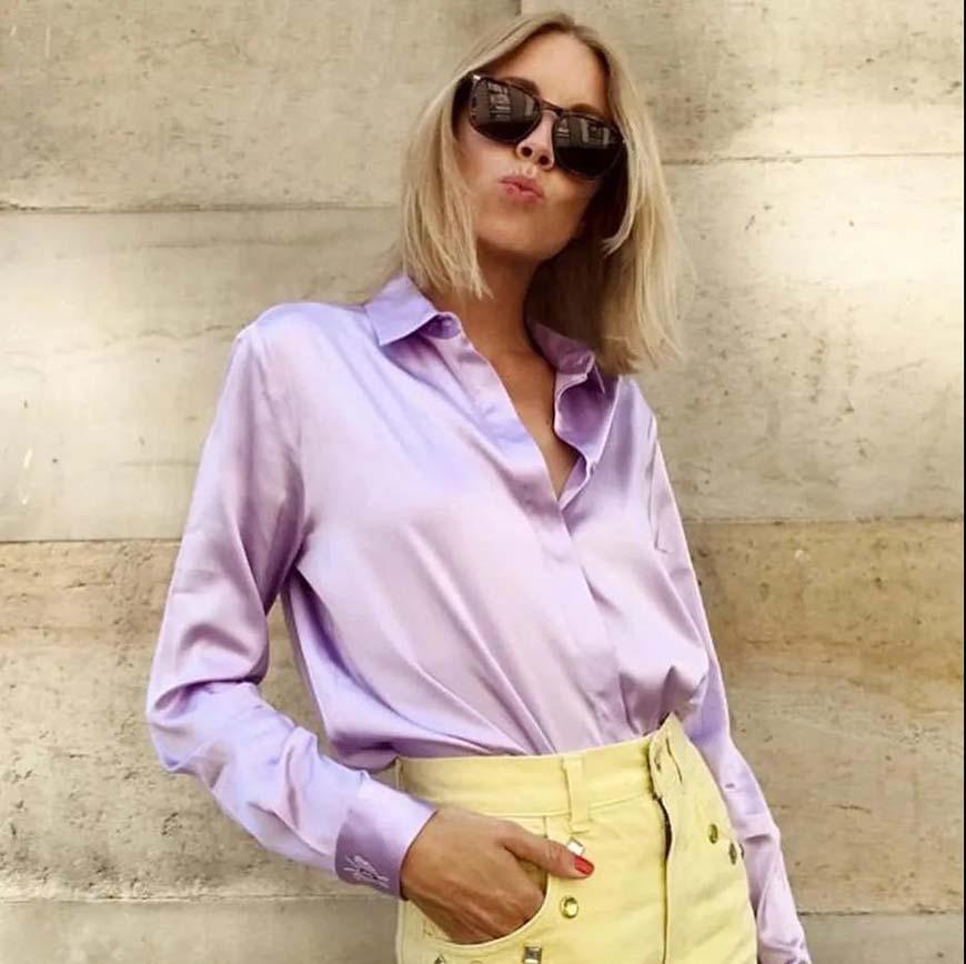 a-woman-wearing-a-purple-blouse