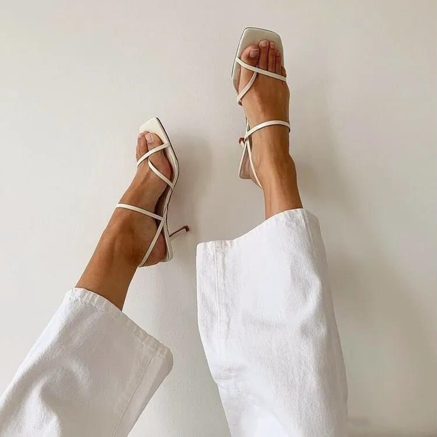 a pair of white sandals