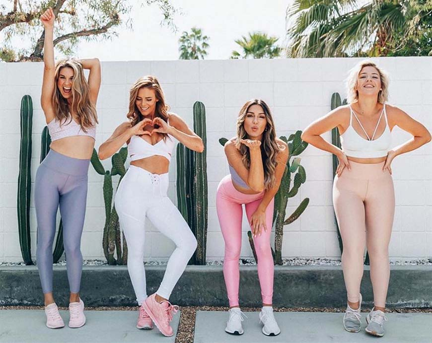 four sexy lady in yoga suits