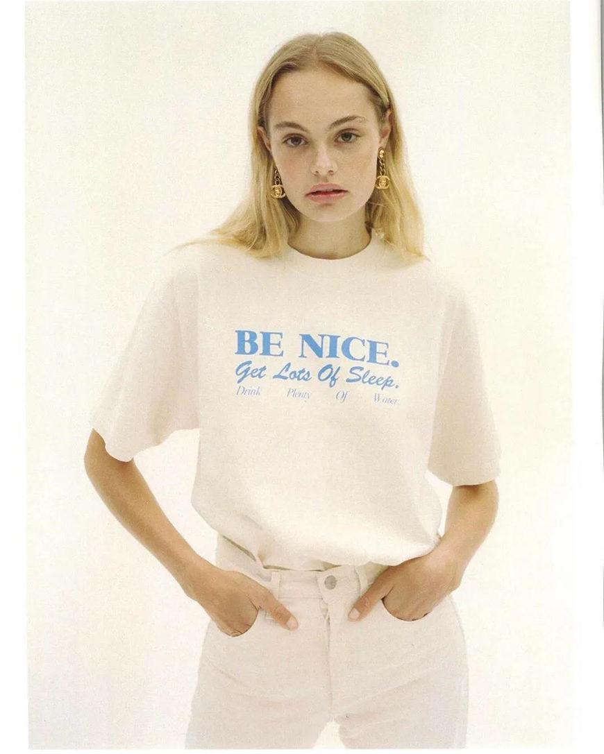 white and blue slogan t-shirts