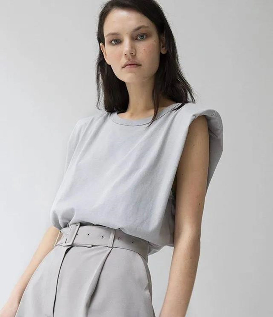 a-sleeveless-T-shirt-and-grey-suit-pants