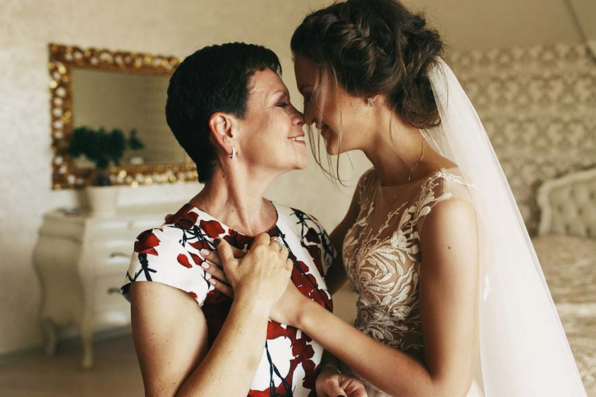 a-bride-and-her-mom-are-smiling