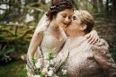 a-mom-is-kissing-her-bride-daughter