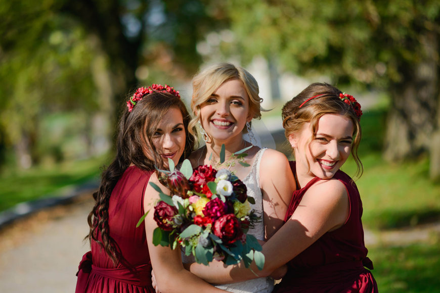 2-bridesmaids-are-hugging-the-bride