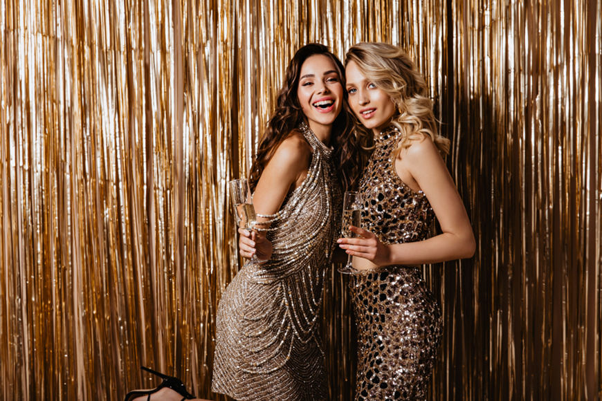 2-girls-in-gold-prom-dresses