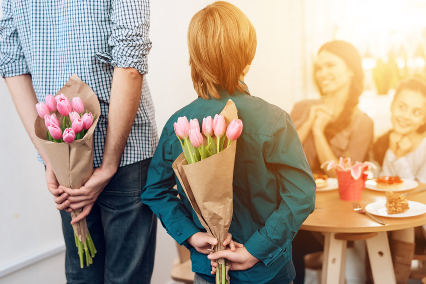 A-man-and-a-boy-give-flowers-to-girls-on-women's-day