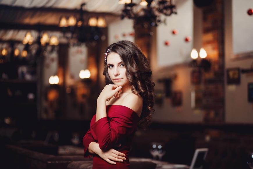 A-woman-in-a-burgundy-ball-dress
