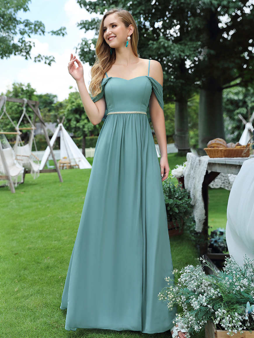 A-woman-in-a-dusty-blue-bridesmaid-dress