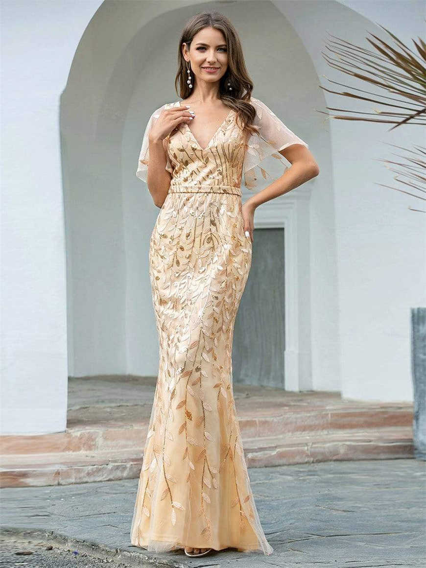A-woman-in-a-gold-V-neck-fishtail-dress