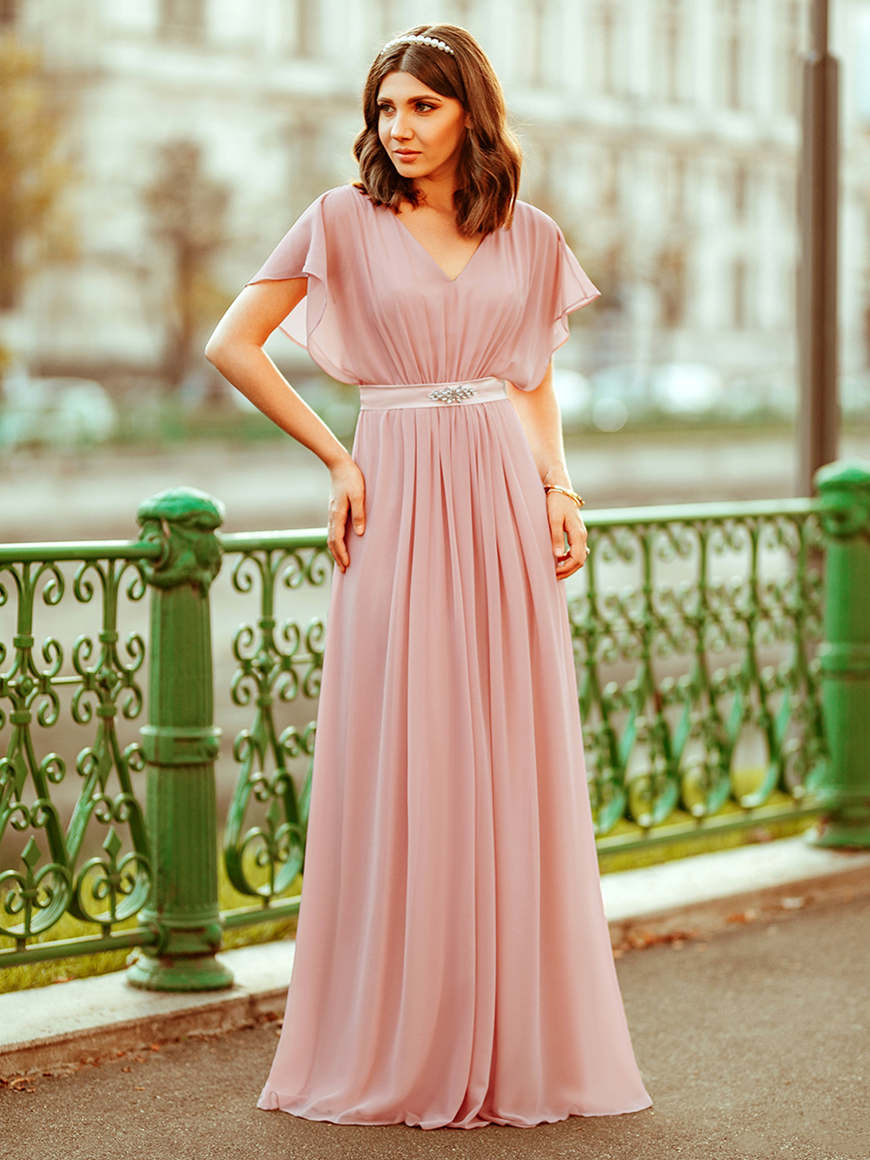 A-woman-in-a-mauve-chiffon-bridesmaid-dress