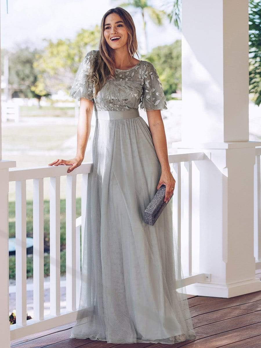 A-woman-in-a-ruffled-grey-dress