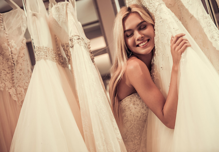 a-women-and-many-wedding-dresses