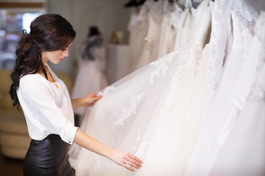 a-women-is-choosing-a-wedding-dress