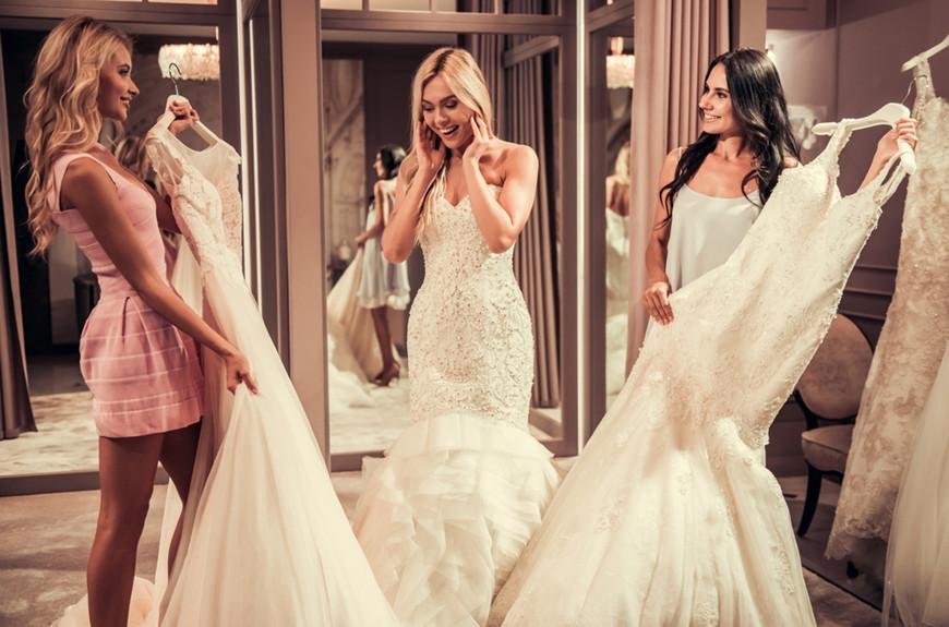 three-women-are-choosing-wedding-dresses