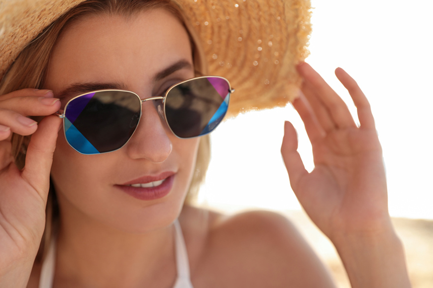woman-wearing-sunglasses-outdoors-on-sunny-day